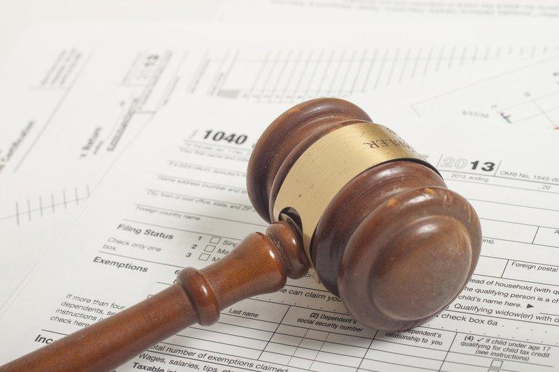 gavel on tax paperwork